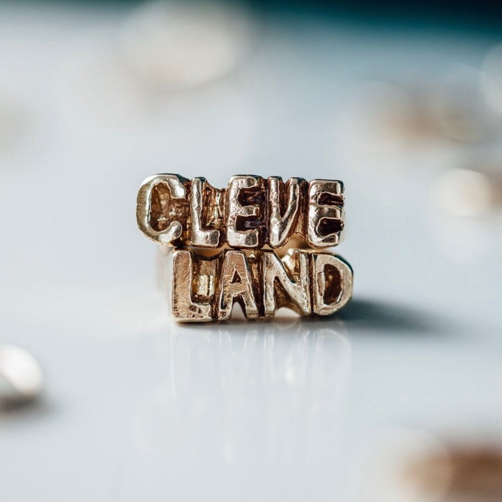 "Image of ""CLEVE"" and ""LAND"" Rings"