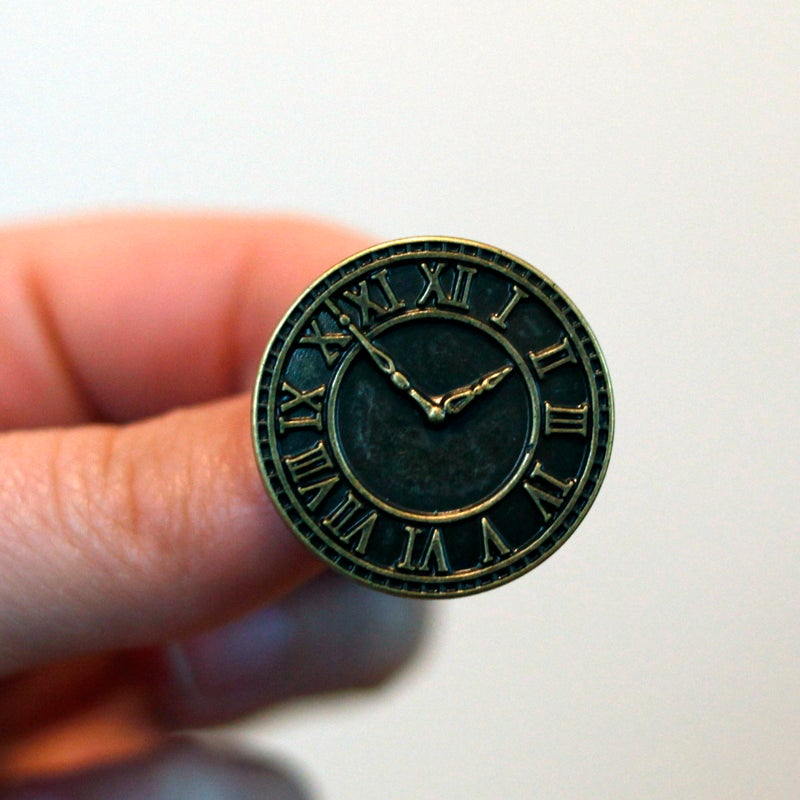 "Image of Bronze Clock Plugs (sizes 3/4-1"")"
