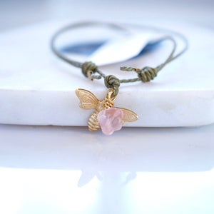 Image of Gold bee and flower bead friendship bracelet