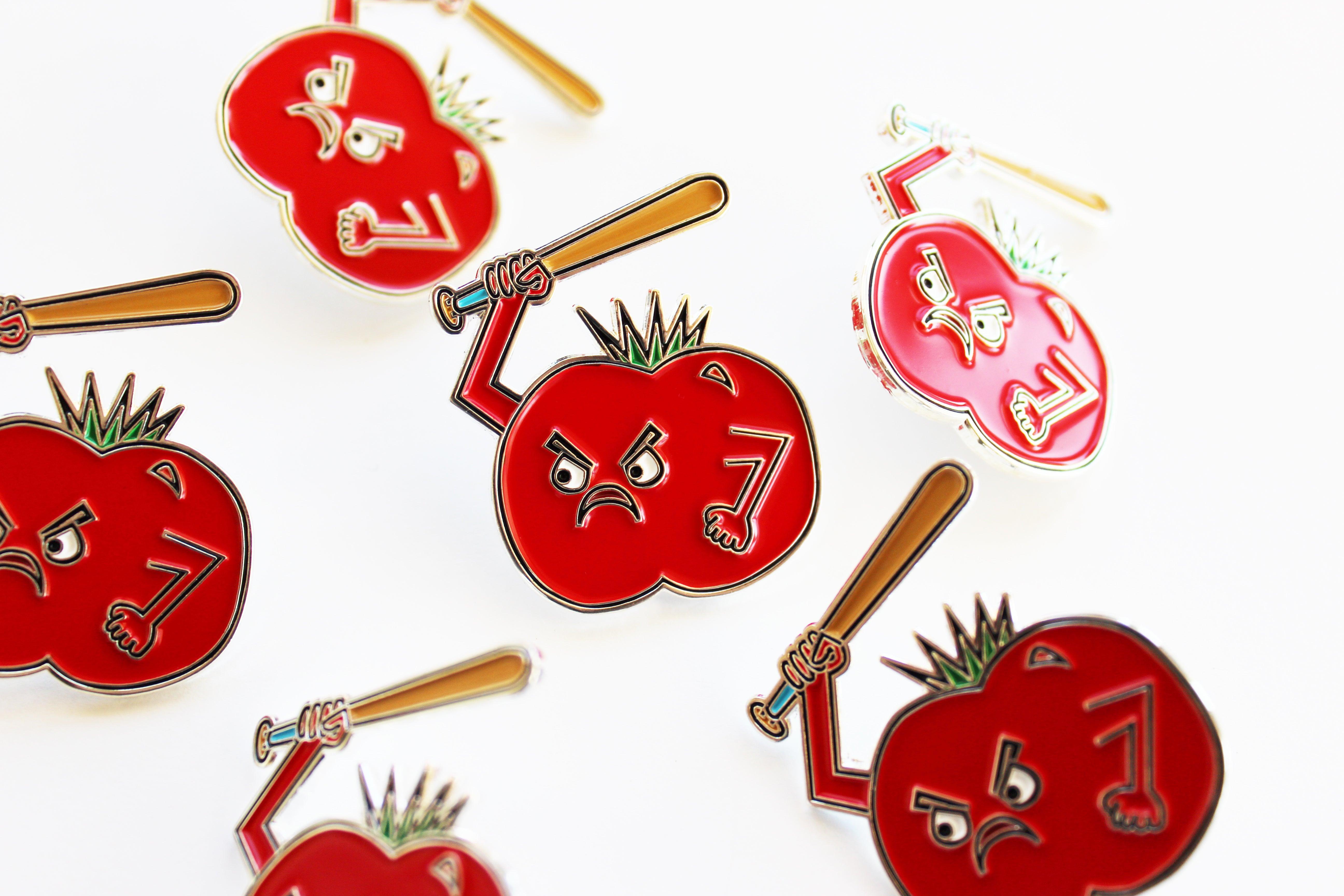 food fight enamel pin tomato with a baseball bat mama bakery