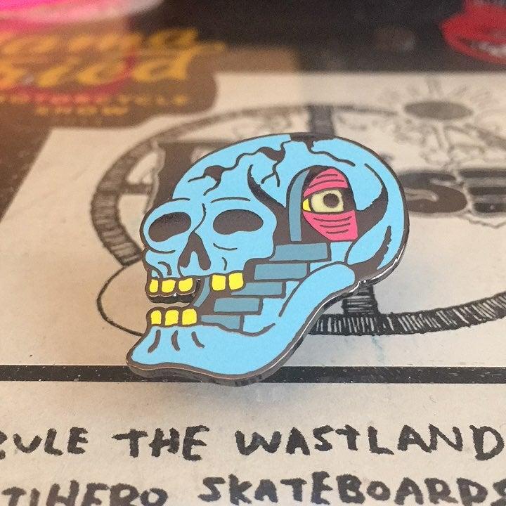Image of skullcase lapel pin