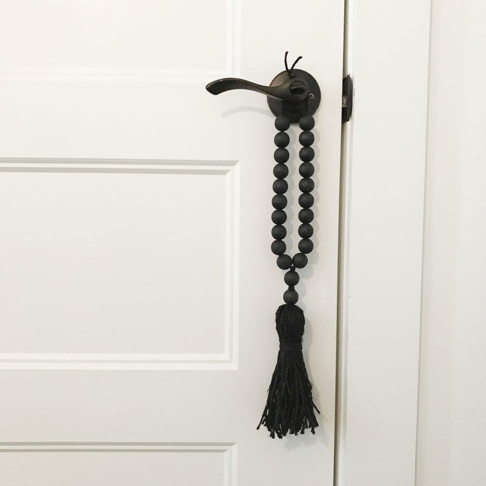 Image of MINI LOVE BEADS - MODERN BLACK, BLACK TASSEL