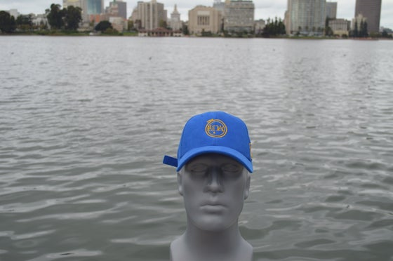 Image of Royal blue and gold constructed polo cap.
