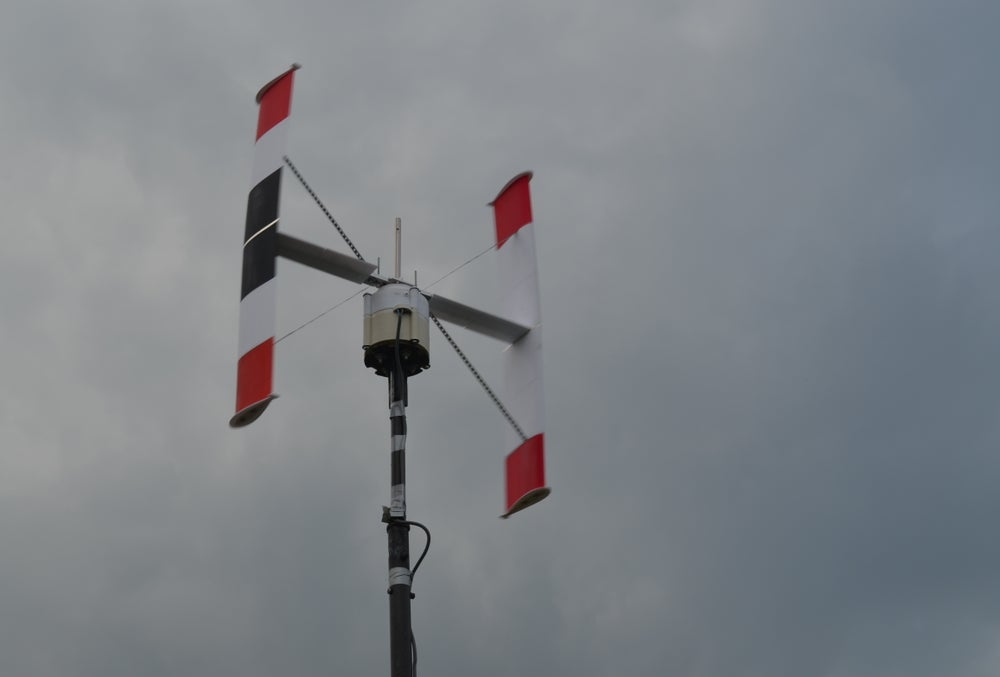 Image of VAWT Darrieus Vertical Axis Wind Turbine with 3 phase axial flux generator