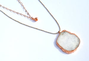 Image of double layered rose gold plated agate slice