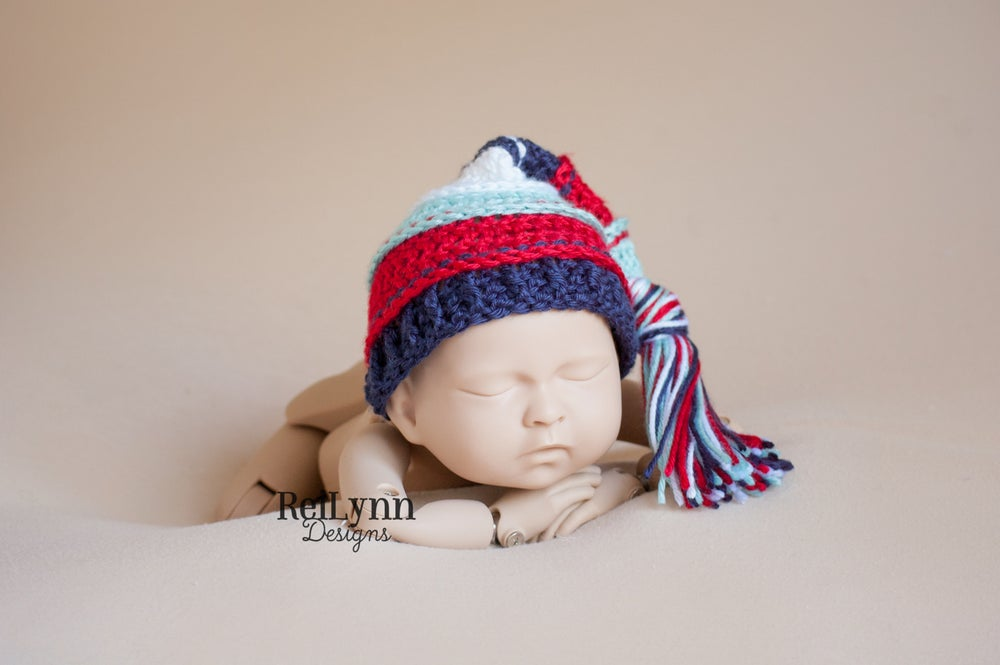 Image of Aqua, Red, Navy, White Tassel Hat