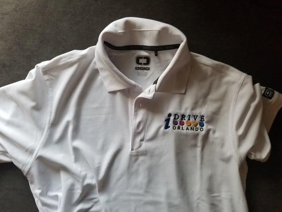 Image of OGIO White Golf Polo Shirt with IDrive Orlando Logo
