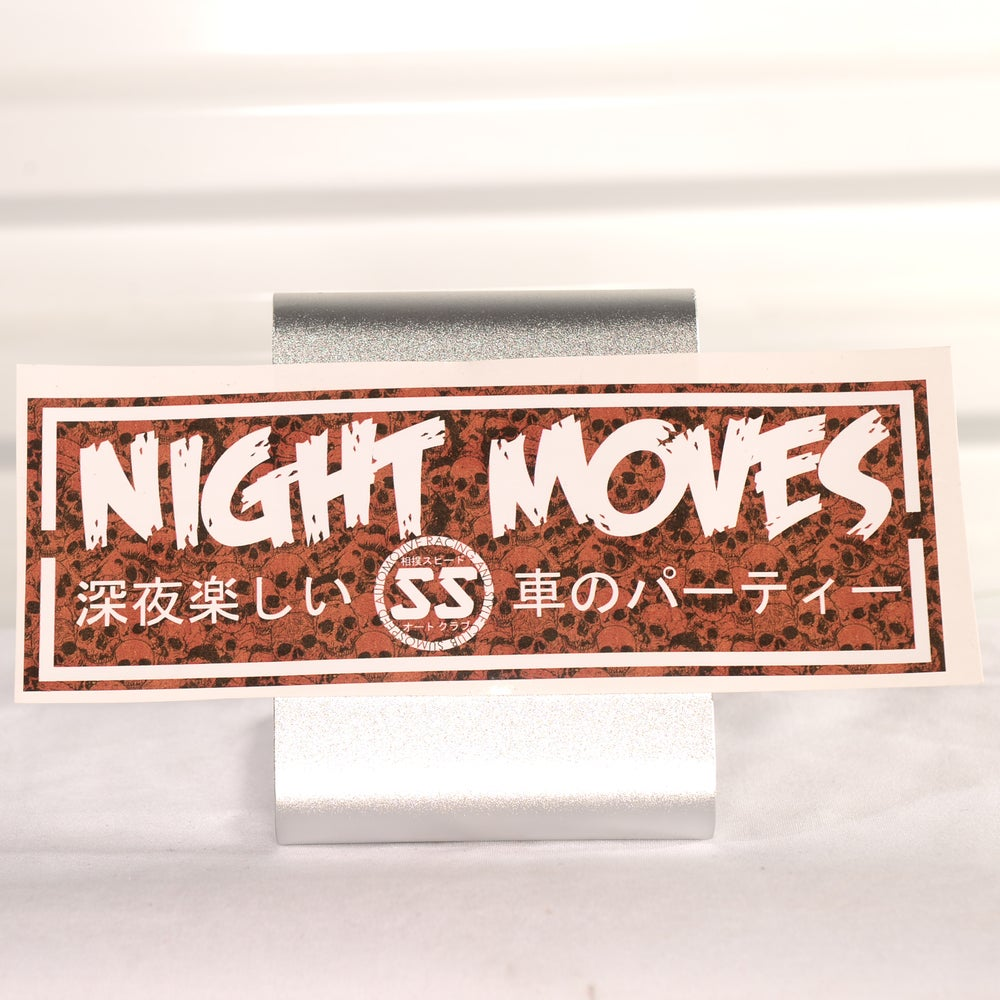 "Image of Printed Night Moves Slap Stickers 9"" x 3"""
