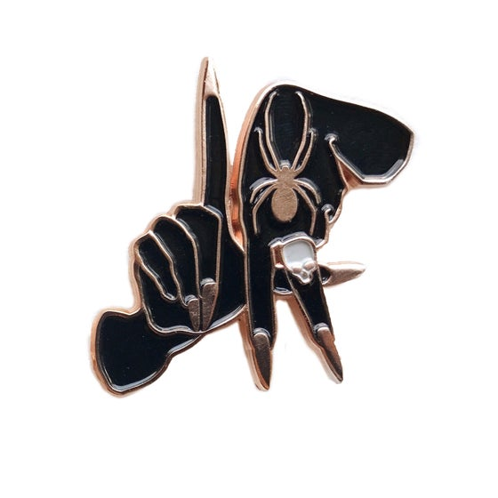 Image of Black and gold soft enamel pin