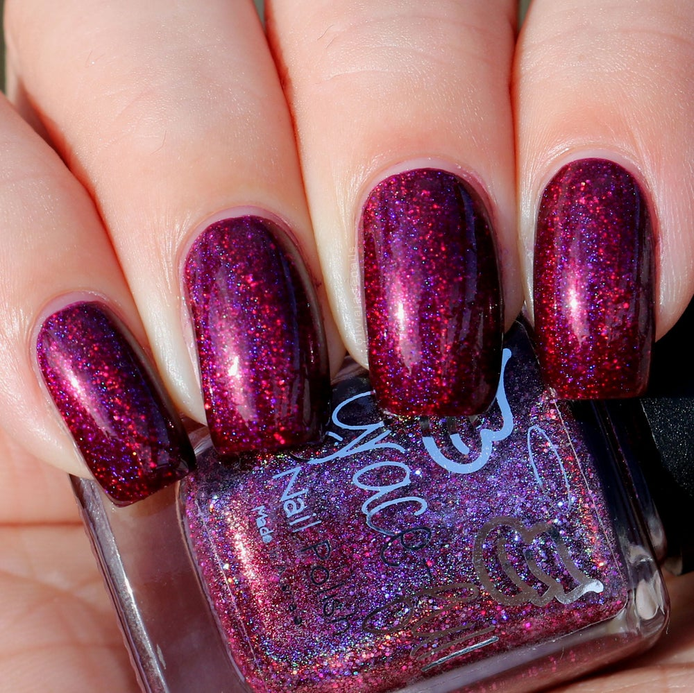 Image of Ghoulish Goop - a deep purple/pink with red undertones in a linear holo