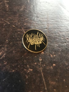 Image of Yellow Eyes logo pin