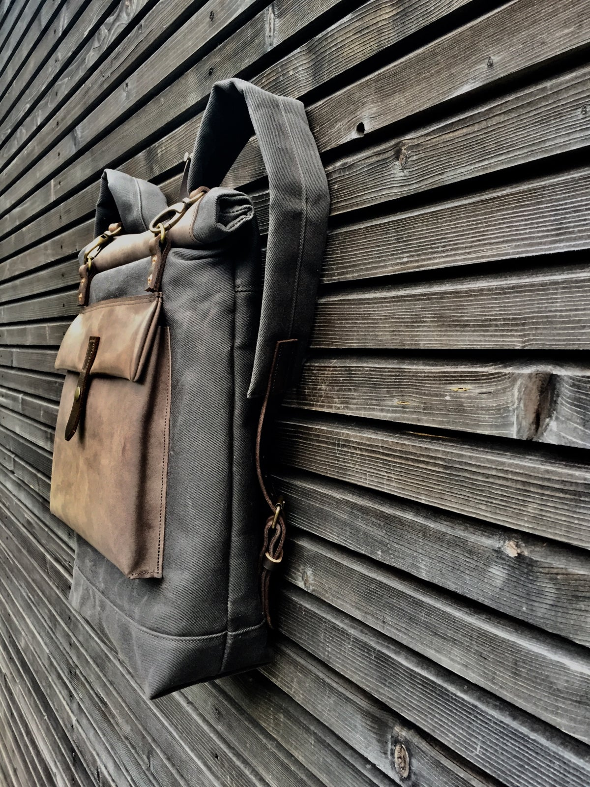 Image of Waxed canvas backpack with roll up top and oiled leather outside pocket COLLECTION UNISEX