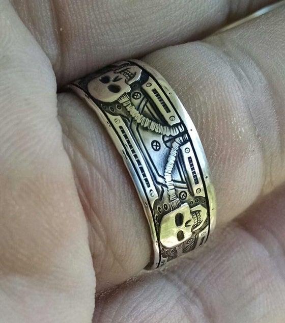 Image of Bio mechanical skull coin ring