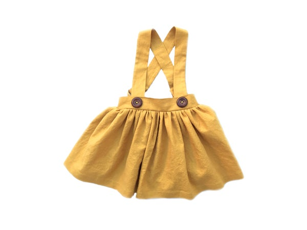 Image of Scout Finch Suspender Skirt in Mustard Linen
