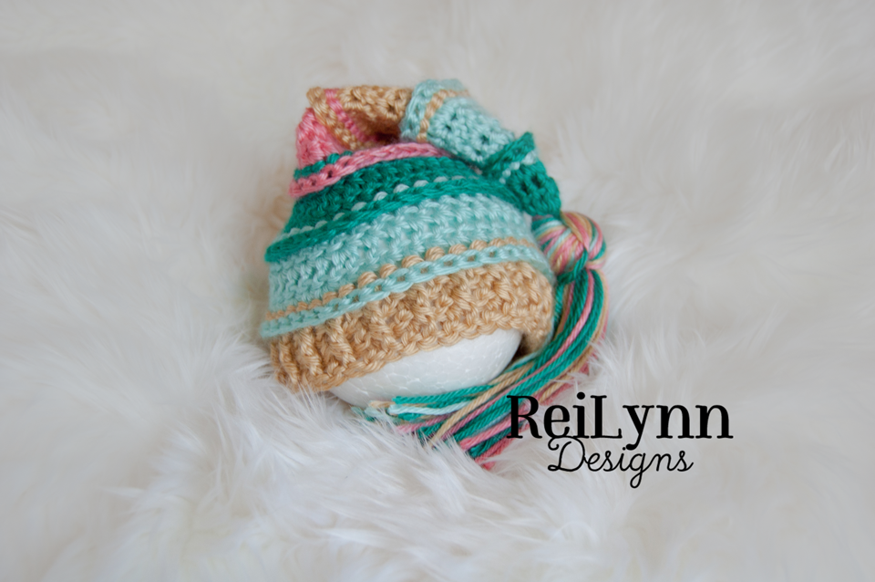 Image of Teal, Aqua, Gold and Coral Tassel Hat