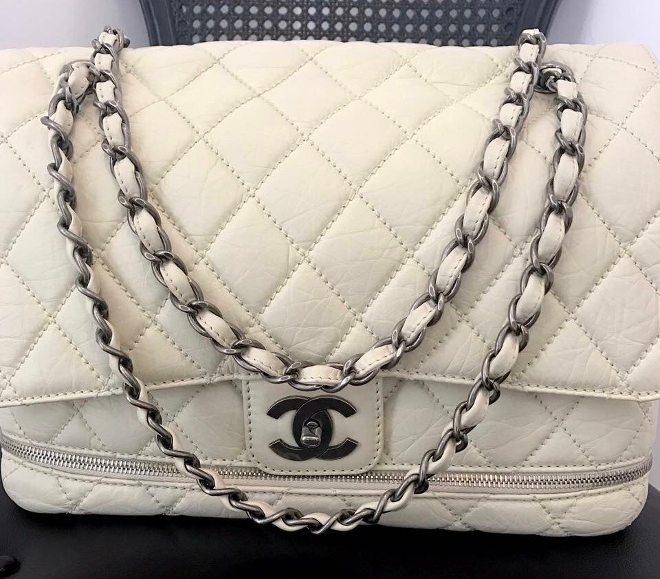 Image of CHANEL PARIS/NEW YORK (PNY) DISTRESSED QUILTED CALFSKIN EXPANDABLE FLAP BAG