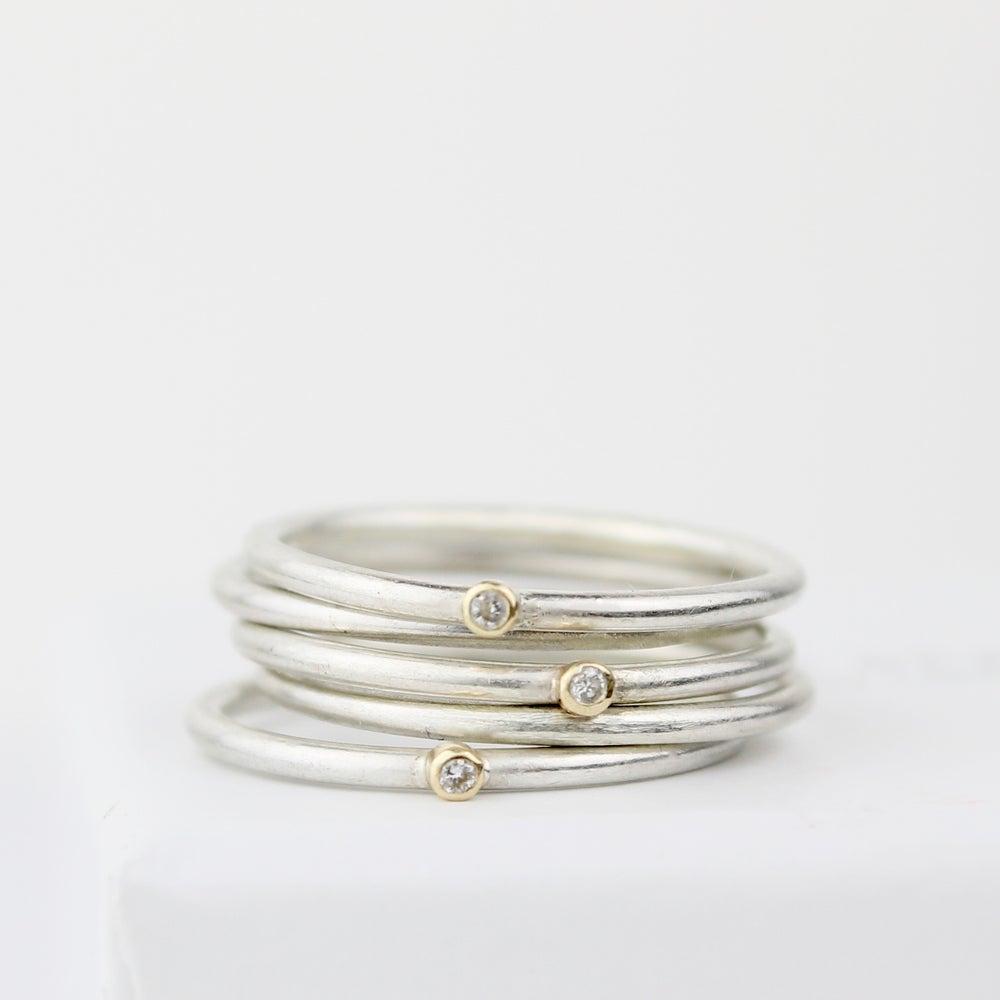 Image of teeny diamond stack (three diamond rings, two plain)