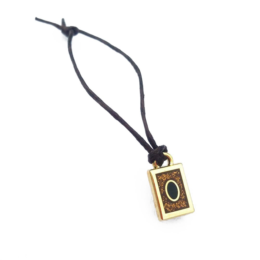 Image of Yu-Gi-Oh inspired Kaiba locket pin