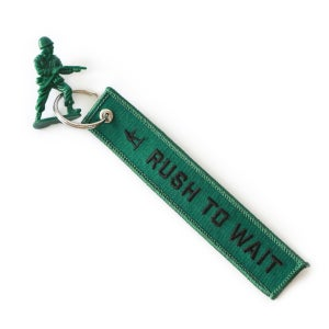 Image of RUSH TO WAIT Keychain Tag
