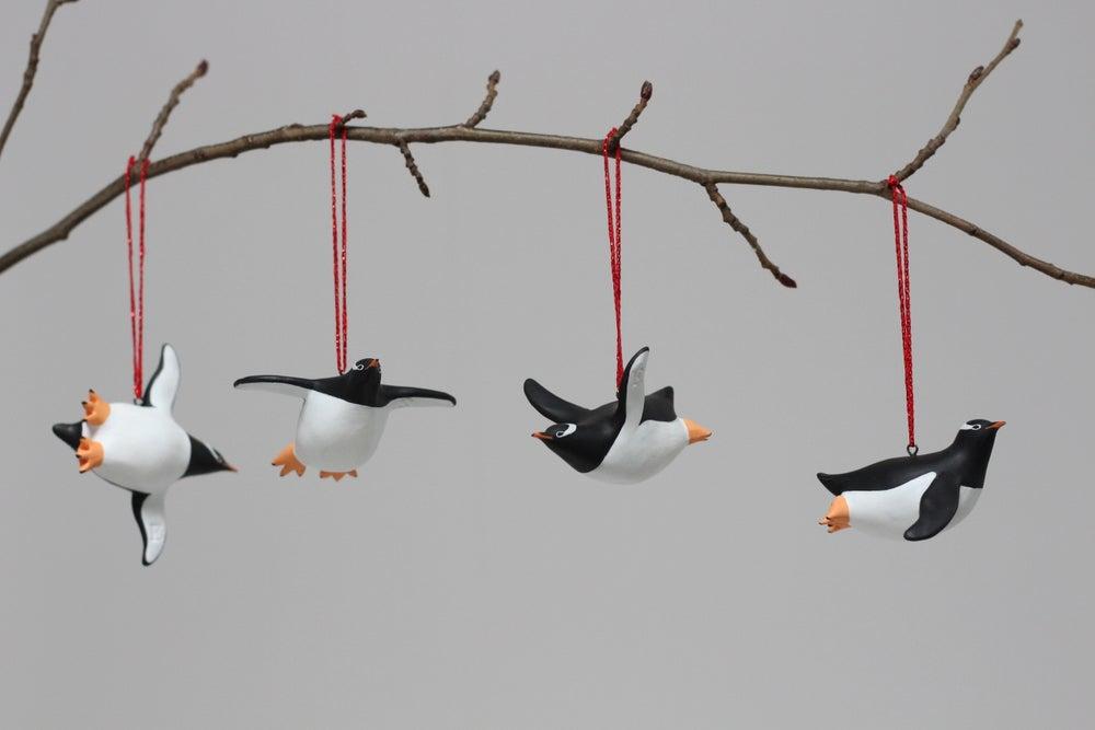Image of Flying Gentoo Penguins