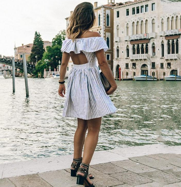 Image of Hot style street with a striped back-and-shoulder dress