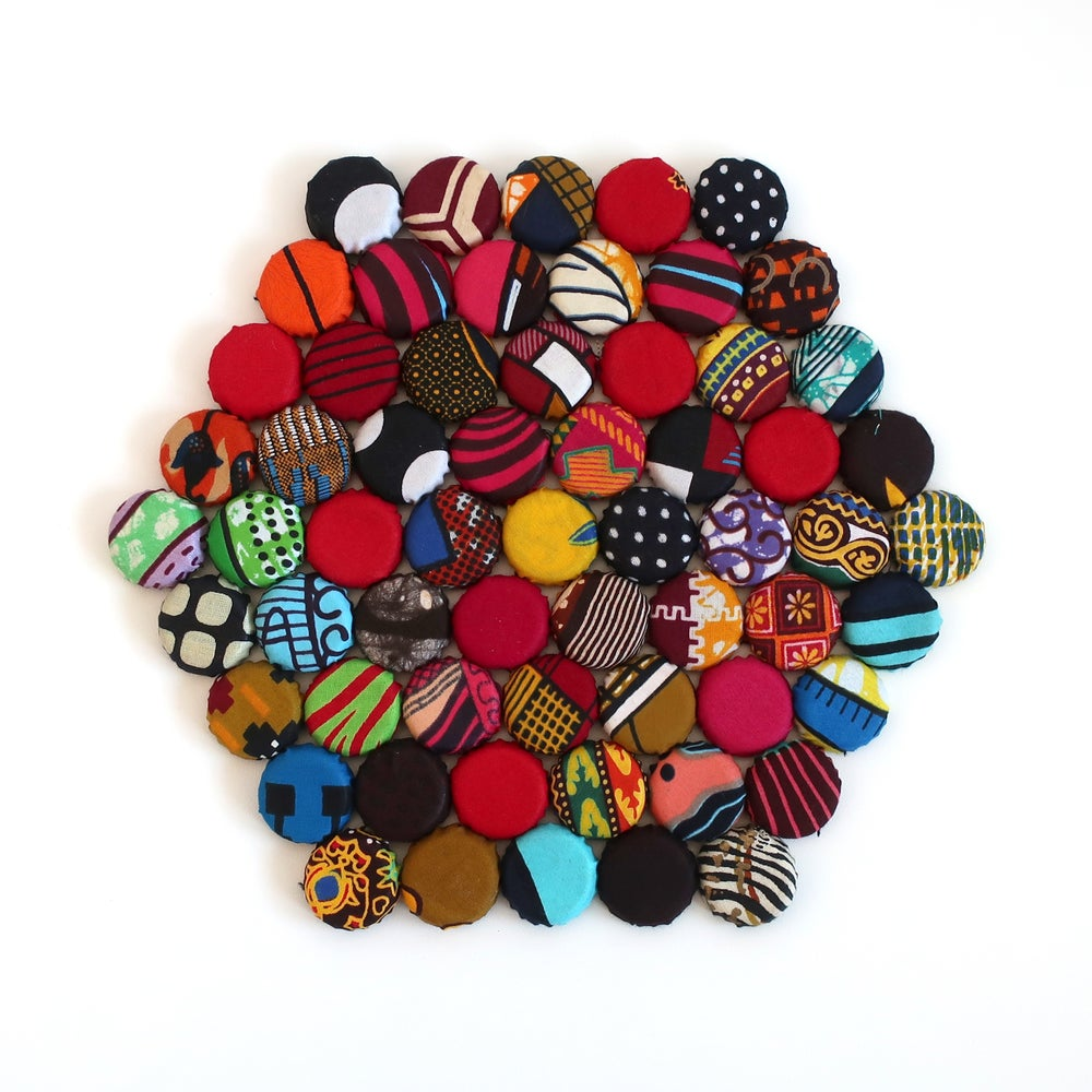 Image of Recycled bottle top table mat