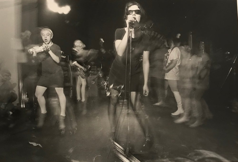 Image of Bikini Kill live in Washington DC, Rock For Choice, April 4th 1992. Thurston Hearts the Who.