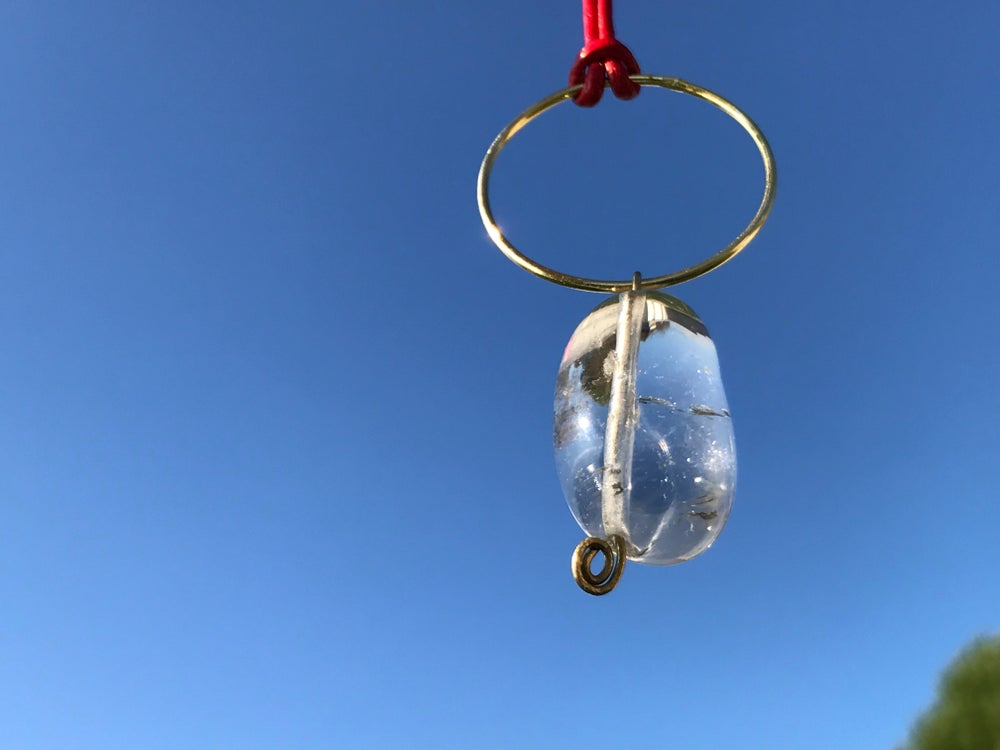 Image of Cristal quartz, gold, red leather pendant