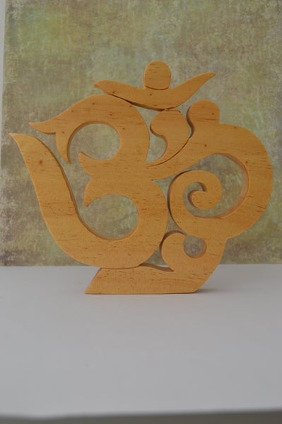 Image of Om symbol wood wall hanging