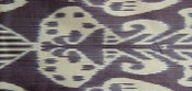 Image of dark ink grey ikat cushion
