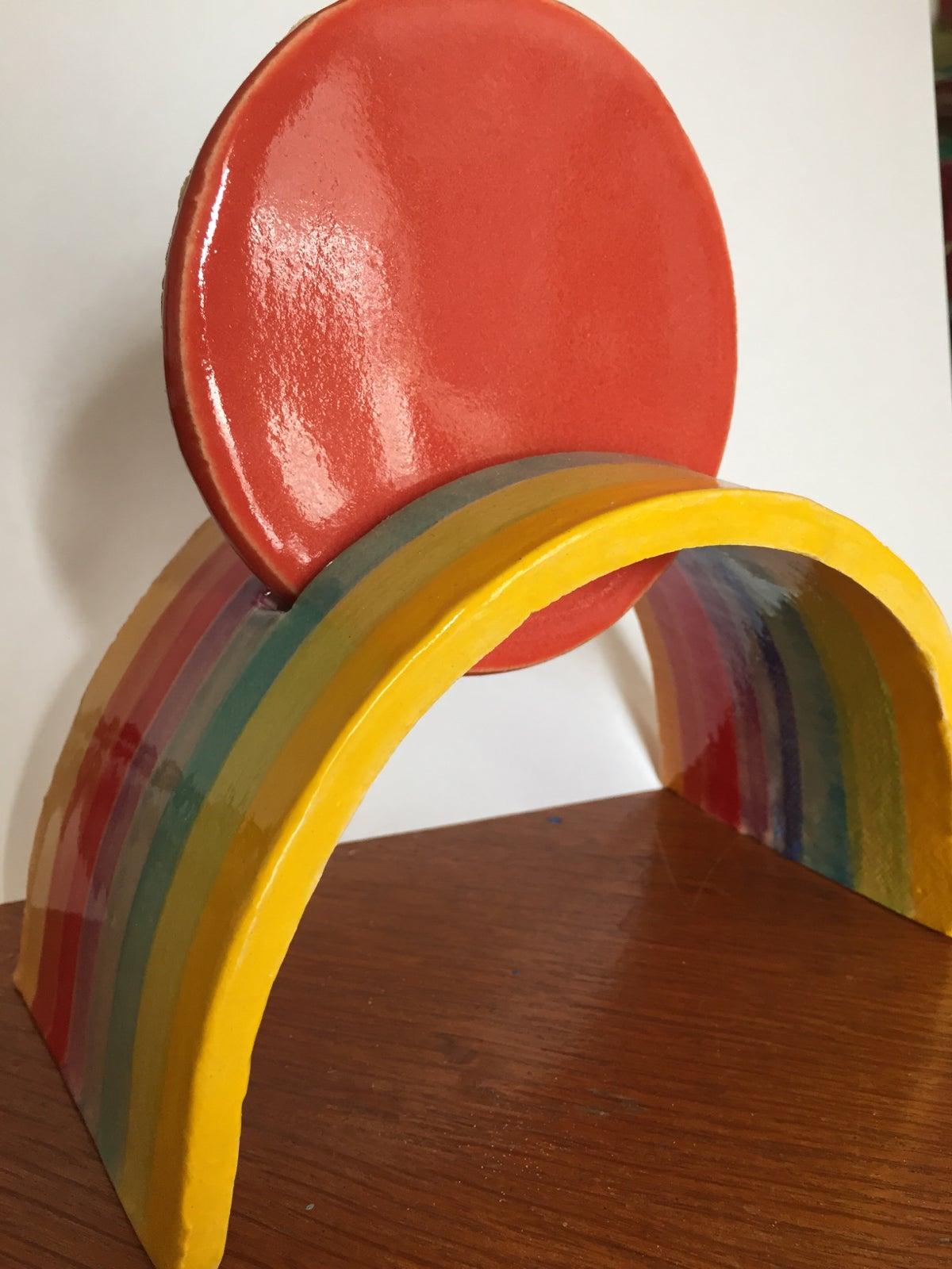 Image of Rainbow cradles the Sun
