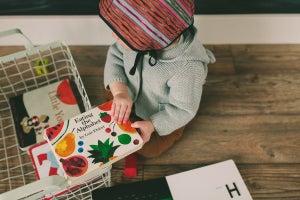 Image of papaya ikat bonnet . handwoven
