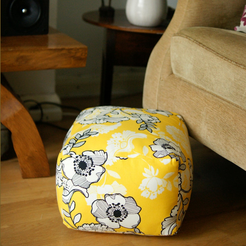 Image of Black and Yellow flower pouffe