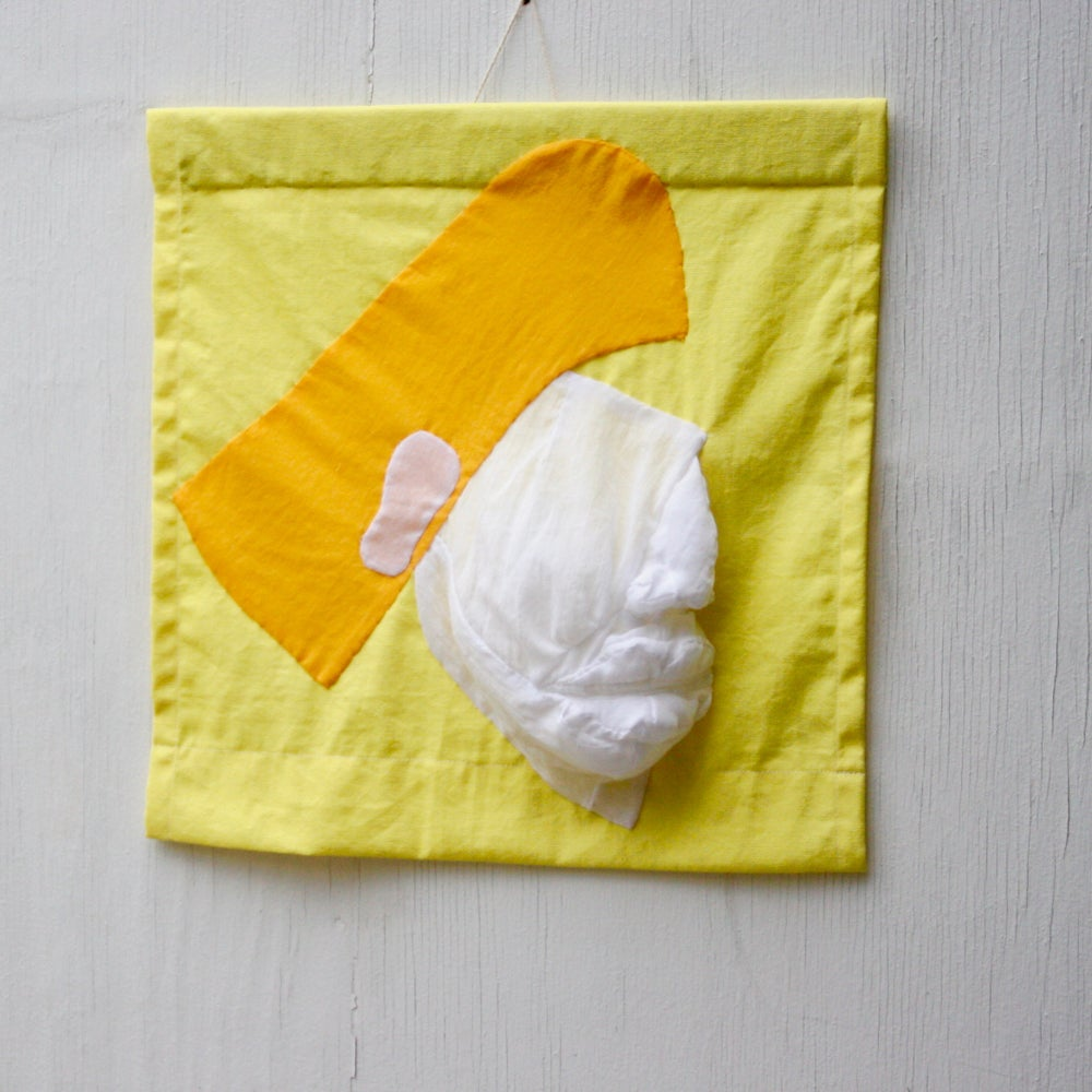 Image of white face with mellow yellow hair
