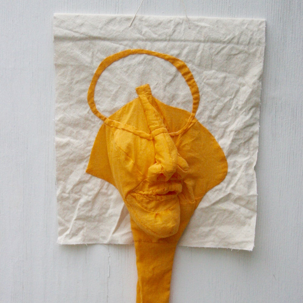 Image of mellow yellow face with long neck and dick/balls
