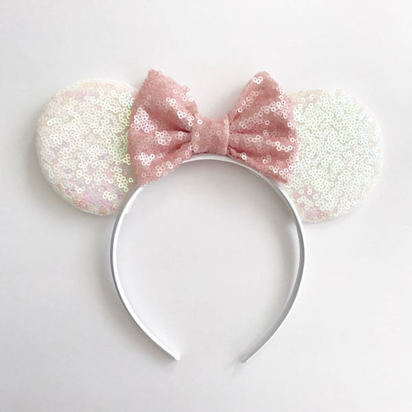 Image of White iridescent sequin mouse ears with blush sequin bow