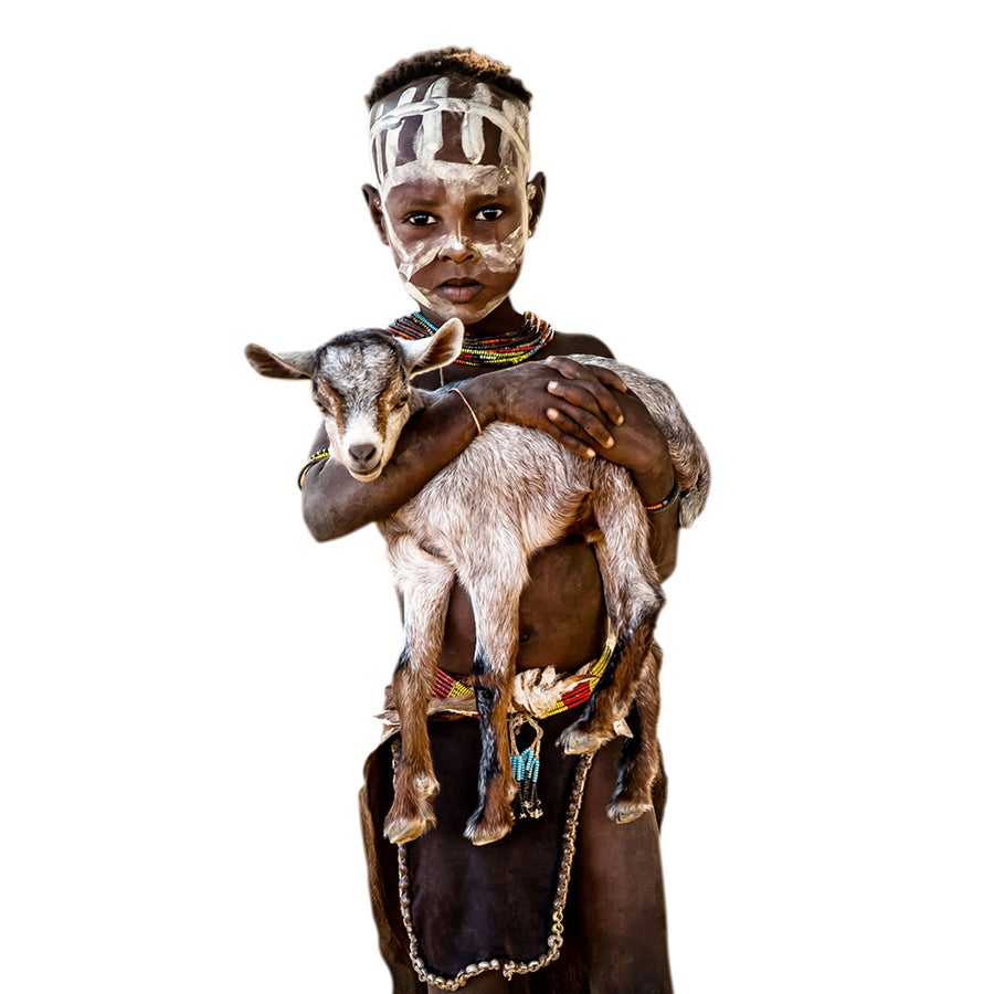 Image of PHOTOGRAPH - JONATHAN - LITTLE KARA BOY WITH BABY GOAT