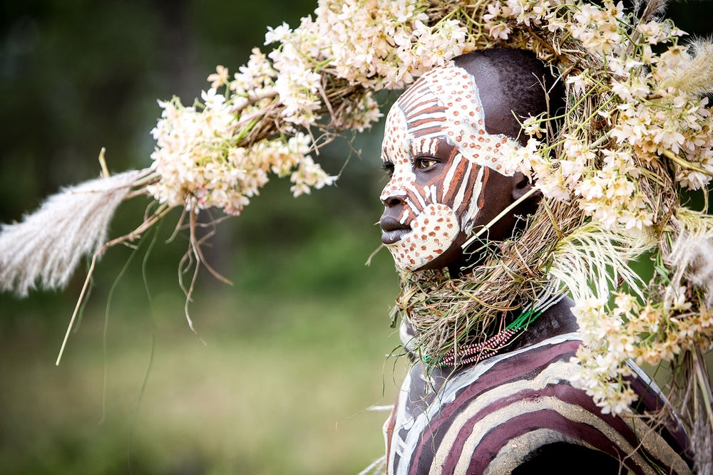 Image of CANVAS - ABEBE - Suri boy with crown of flowers