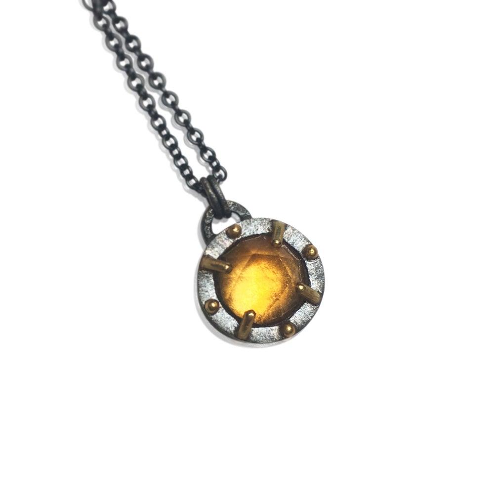 Image of mixed metal juju necklace