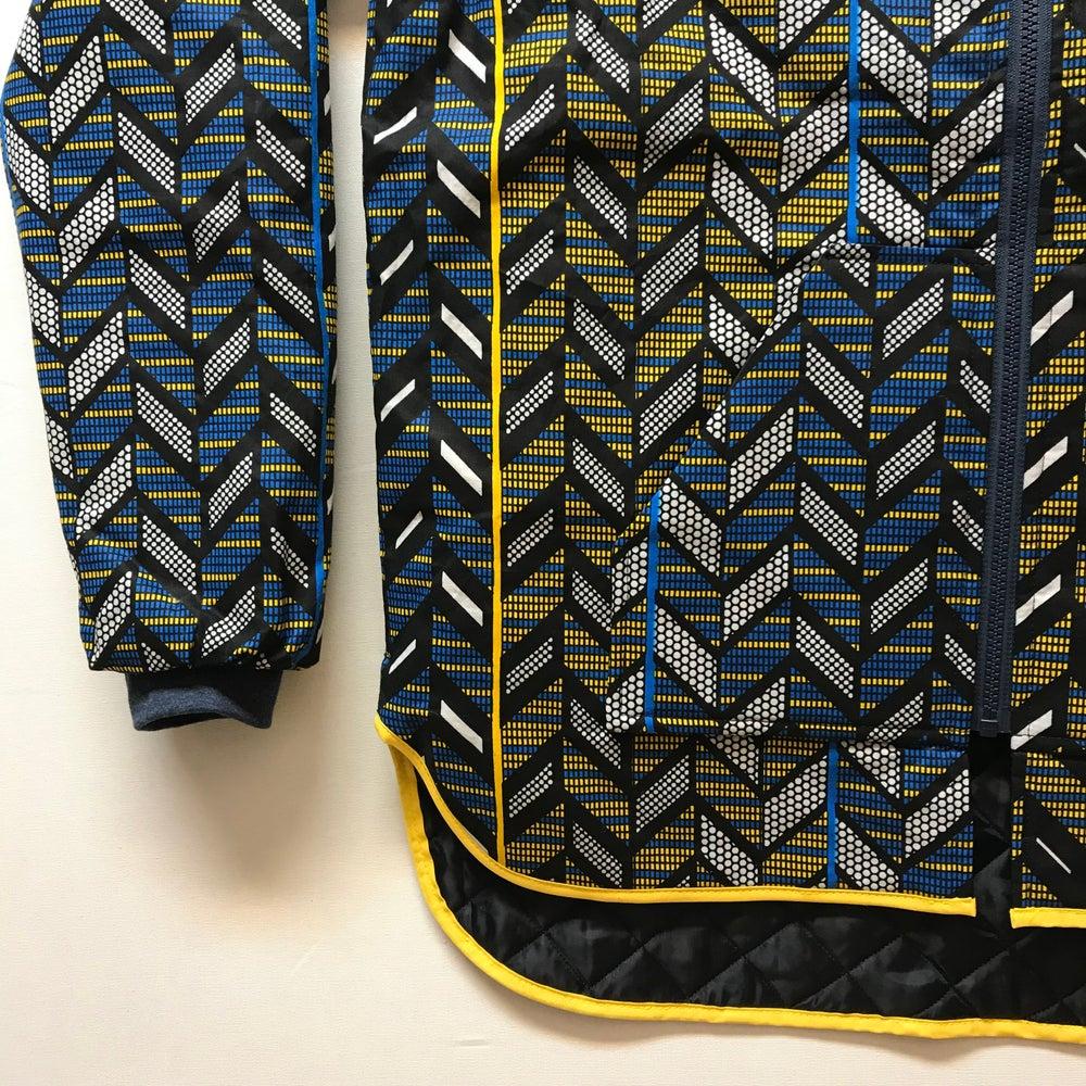 Image of Unisex termojakke med blå/gul/sort sildebens print (s)