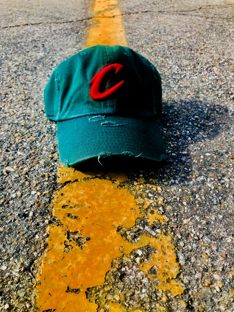 Image of Red Eye C Stressed Dad Hat Raised lettering