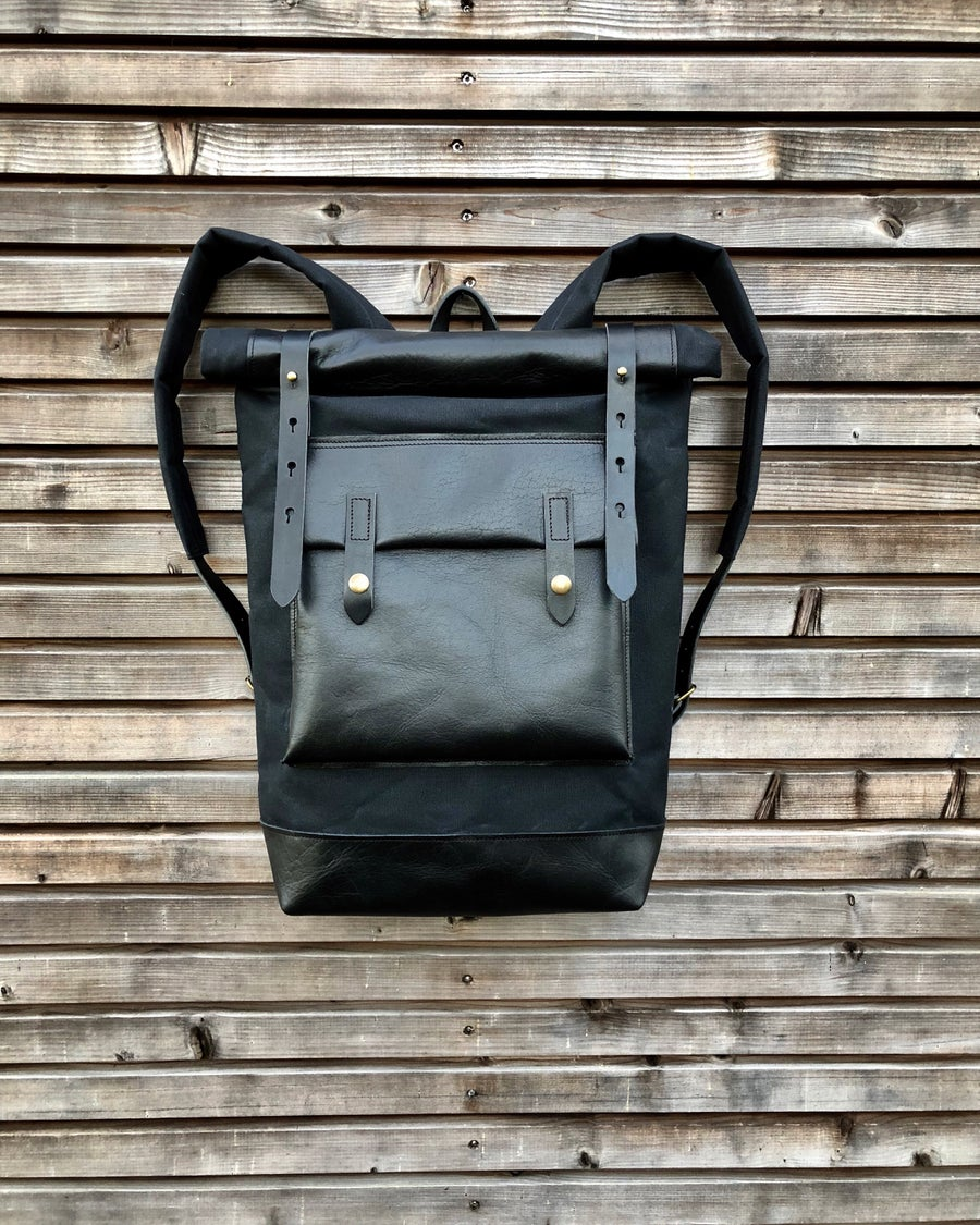 Image of Black waxed canvas rucksack/backpack with roll up top and oiled leather bottem COLLECTION UNISEX