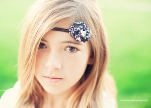 Image of Black and White on a thin headband