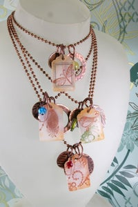"""Image of copper and poly """"luggage"""" tags"""