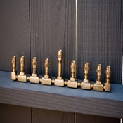 Image of Mini-Orah (the small, brass menorah)