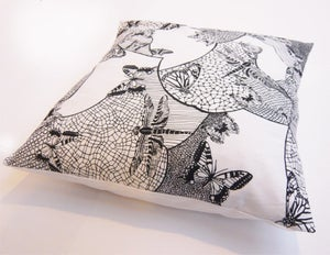 Image of Black and white lace and insect cushion