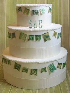 Image of Green Vintage Stamp Wedding Cake Garland