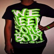 """Image of  Purple/Green """"We Need Somebody"""" T-shirts"""