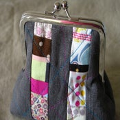 Image of patchwork strips fatty clutch