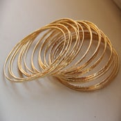 Image of Set of 5 thin / skinny / tiny  14k gold filled handmade hammered stackable / stack bangles / bracele